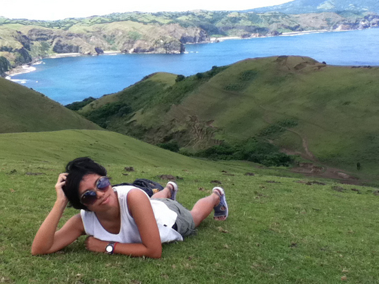 Vira trying to hide her exhaustion after climbing the hill in Batanes, Philippines