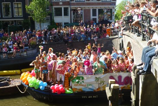 Crowds line the bridges and streets to see the floats
