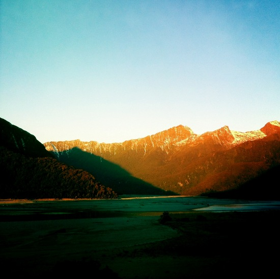 The West Coast mountains at sunset not far from Haast