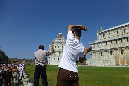 People holding up the leaning tower of Pisa